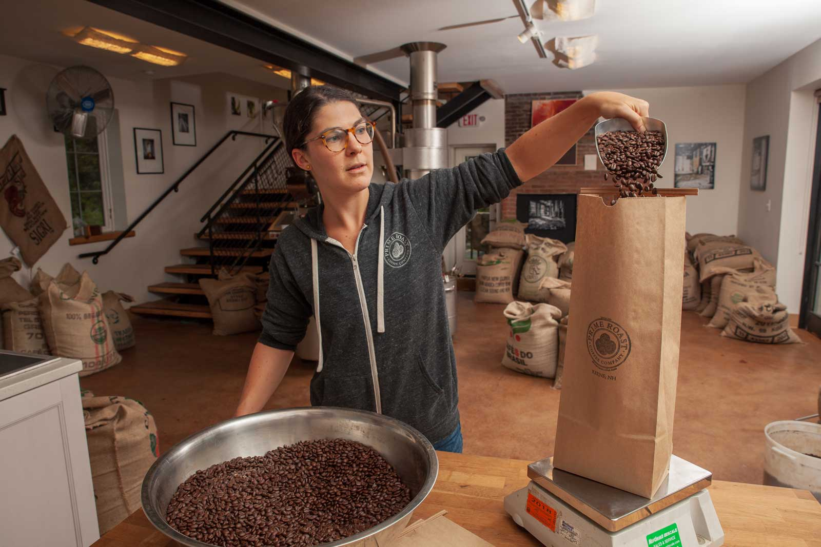 Emily Packaging Coffee at the Roastery in Keene New Hampshire
