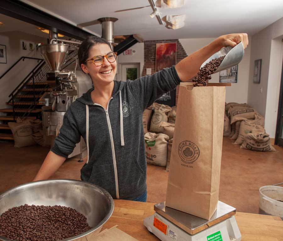 Emily Packaging Coffee at the Roastery